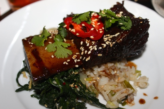 Sichuan style beef ribs in fire sauce with braised greens and garlic rice